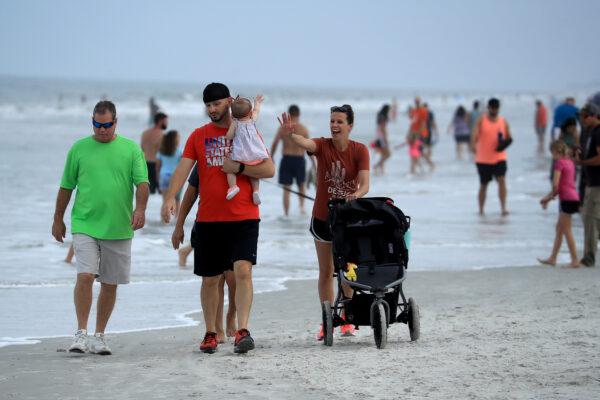 People walk down Jacksonville Beach