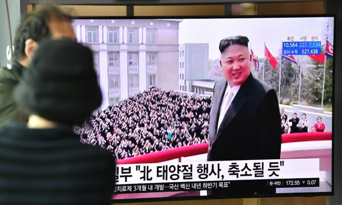People watch a television news broadcast showing file footage of North Korean leader Kim Jong Un, at a railway station in Seoul, South Korea, on April 14, 2020. (Jung Yeon-Je/AFP via Getty Images)