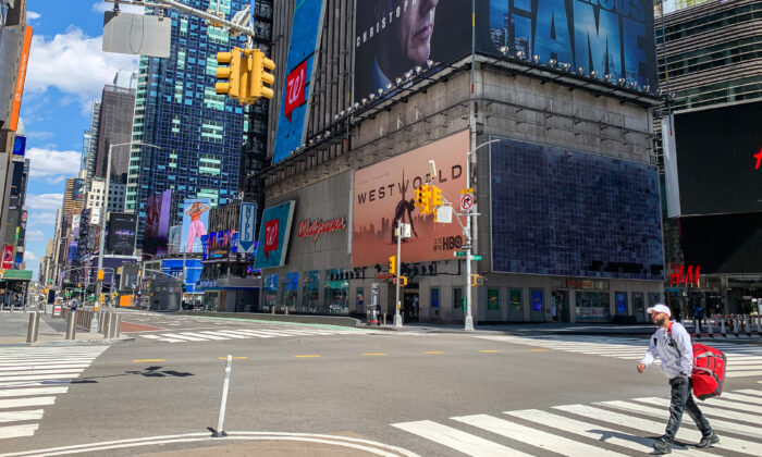 The nearly empty street view outside Times Square subway station in New York on April 15, 2020. (Chung I Ho/The Epoch Times)