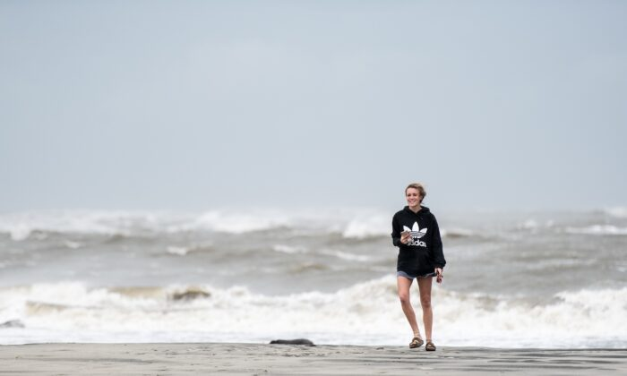 A woman on Sullivan's Island, South Carolina, in a file photograph. (Sean Rayford/Getty Images)