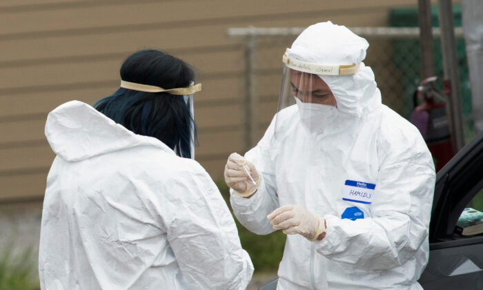 Medical professionals conduct tests for COVID-19 in Bolinas, Calif., on April 20, 2020. (Kate Munsch/Reuters)