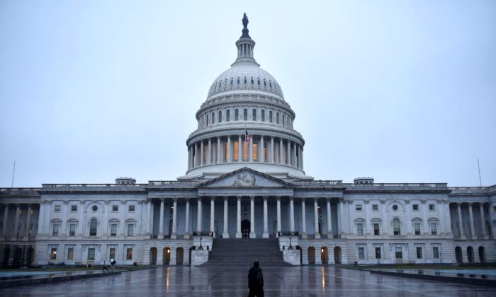A man walks in front of the U.S. Capitol, in Washington, on Nov. 6, 2018. (Mandel Ngan/AFP/Getty Images)