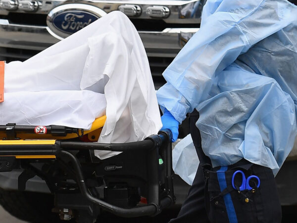 Medical staff move a patient into the Wyckoff Heights Medical Center emergency room