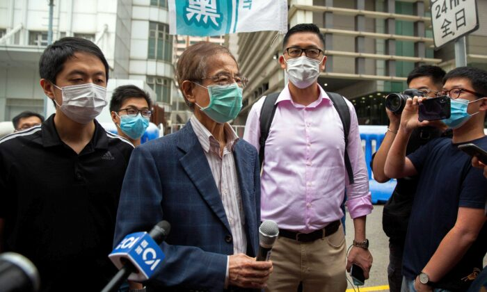 Former lawmaker and pro-democracy activist Martin Lee (C-L) talks to members of the media as he leaves the Central District police station in Hong Kong on April 18, 2020, after being arrested and accused of organising and taking part in an unlawful assembly in August last year. (Isaac Lawrence/AFP via Getty Images)