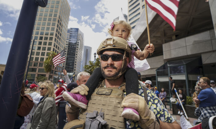 """Demonstrators protest during a """"Freedom Rally"""" against Stay-At-Home Directives in San Diego, California, on April 18, 2020. (Sandy Huffaker/Getty Images)"""