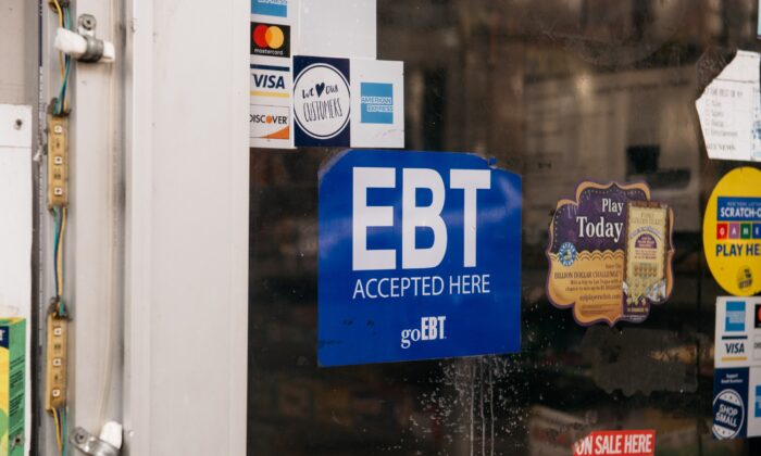 A sign alerting customers about SNAP food stamps benefits is displayed at a Brooklyn grocery store in New York City on Dec. 5, 2019. (Scott Heins/Getty Images)