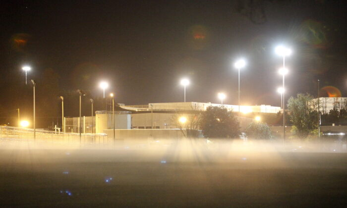 Fog drifts across a field in front of one of the two medium-security prisons inside the Federal Corrections Complex in Butner, North Carolina, on Nov. 20, 2015. (Reuters/Jonathan Drake)