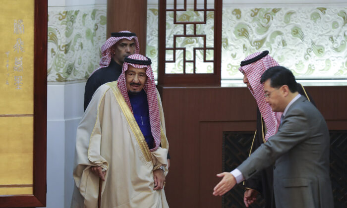 Saudi King Salman bin Abdulaziz (L) arrives to attend a signing ceremony at the Great Hall of the People in Beijing on March 16, 2017. Xi welcomed visiting Saudi King Salman in Beijing as China continues a charm offensive toward the Middle East, a region where it has long kept a low profile. (Lintao Zhang/AFP via Getty Images)