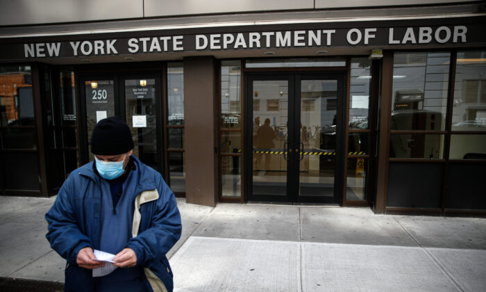 Visitors to the New York State Department of Labor are turned away at the door by personnel due to closures over CCP virus concerns in New York, on March 18, 2020. (John Minchillo/AP Photo)
