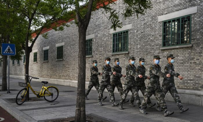 Chinese military march in the street in Beijing, China on April 22, 2020. (Kevin Frayer/Getty Images)