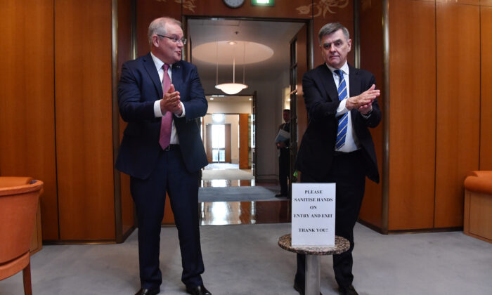 Prime Minister Scott Morrison and Chief Medical Officer for the Australian Government Professor Brendan Murphy sanitise their hands on arrival for a National Cabinet meeting at Parliament House on March 20, 2020 in Canberra, Australia. (Photo by Sam Mooy/Getty Images)
