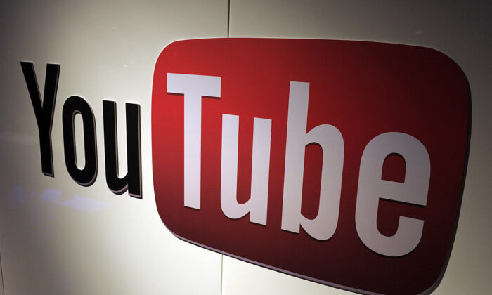 YouTube logo on display during LeWeb Paris 2012 on Dec. 4, 2012. (Eric Piermont/AFP via Getty Images)