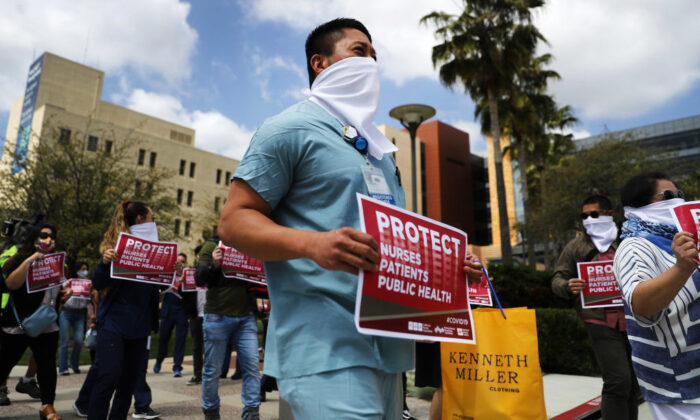 Nurses and supporters protest about the lack of personal protective gear available at UCI Medical Center amid the CCP virus pandemic in Orange, Calif., on April 3, 2020. (Mario Tama/Getty Images)