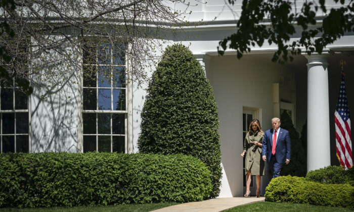 President Donald Trump and First Lady Melania Trump exit the Oval Office as they arrive to participate in a tree planting ceremony in recognition of Earth Day and Arbor Day on the South Lawn of the White House on April 22, 2020. (Drew Angerer/Getty Images)