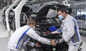 With Masks and Distancing, Volkswagen Restarts Production