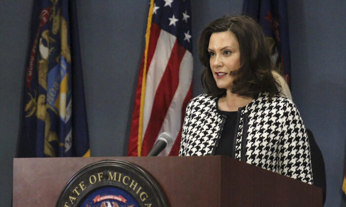 In this photo, provided by the Michigan Office of the Governor, Michigan Gov. Gretchen Whitmer addresses the state in Lansing on April 20, 2020. (Michigan Office of the Governor via AP, Pool)