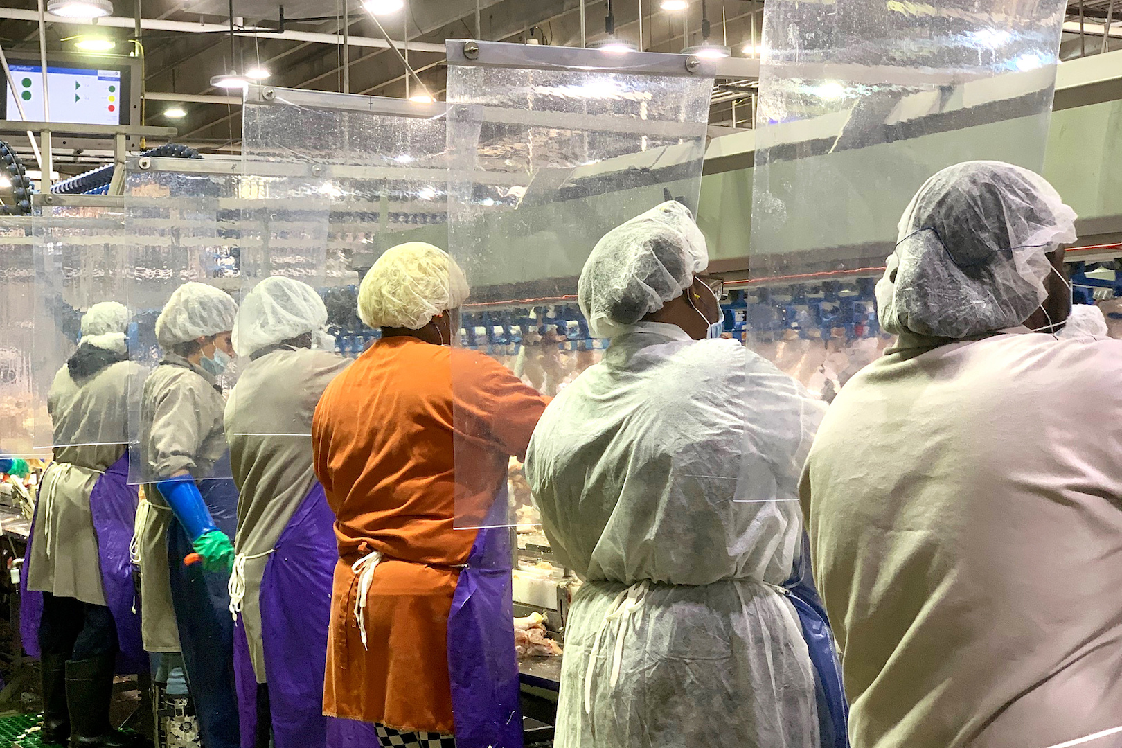 Tyson Foods are workers wearing protective masks