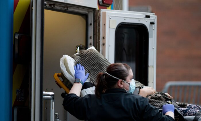 A person is transported into the emergency room of the Elmhurst Hospital in Queens, New York City, on April 22, 2020. (Johannes Eisele/AFP via Getty Images)