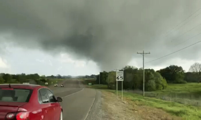 This image made from video provided by Thomas Marcum shows a tornado seen from State Highway 48 in Durant, Okla., on April 22, 2020. (Thomas Marcum via AP)