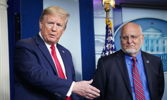 President Donald Trump, left, and CDC Director Robert Redfield participate in the daily briefing on the CCP virus in the Brady Briefing Room of the White House on April 22, 2020. (Mandel Ngan/AFP via Getty Images)