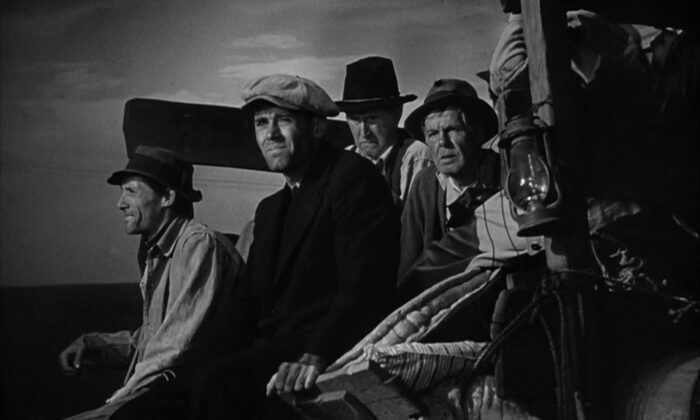 "The rural poor heading west in an old jalopy. Henry Fonda (C) stars in ""The Grapes of Wrath."" (Twentieth Century Fox)"