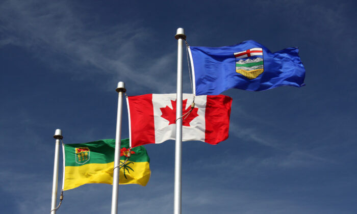 The flags of Saskatchewan, Canada, and Alberta flying  in Lloydminster in a file photo. (Public Domain)