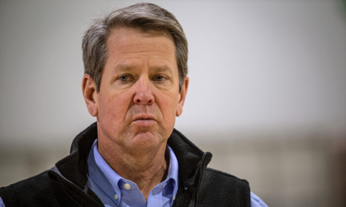 Georgia Gov. Brian Kemp listens to a question from the press during a tour of a temporary hospital at the Georgia World Congress Center in Atlanta, Ga., on April 16, 2020. (Ron Harris/AP Photo)