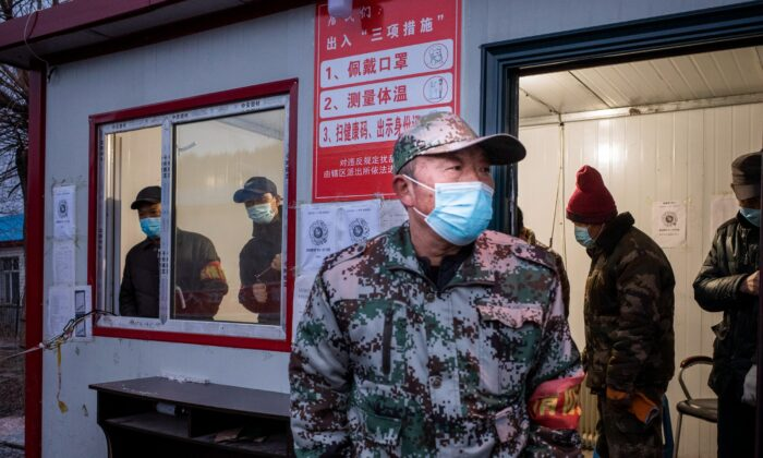 A staff member keeping watch at a checkpoint in the border city of Suifenhe, in China's northeastern Heilongjiang Province on April 21, 2020. (STR/AFP via Getty Images)