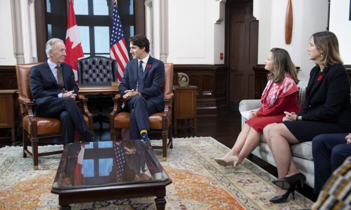 Canada's Minister of Foreign Affairs Chrystia Freeland (second from right), and Acting Ambassador of Canada to the United States of America Kirsten Hillman (right), look on as Prime Minister Justin Trudeau speaks with Richard Neal, Chairman of the Committee on Ways and Means of the United States House of Representatives on Parliament Hill in Ottawa, on Nov. 6, 2019. (The Canadian Press/Adrian Wyld)