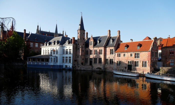 Tourist boats are seen in a canal of the old town of Bruges during the lockdown imposed by the Belgian government. (REUTERS/Francois Lenoir)