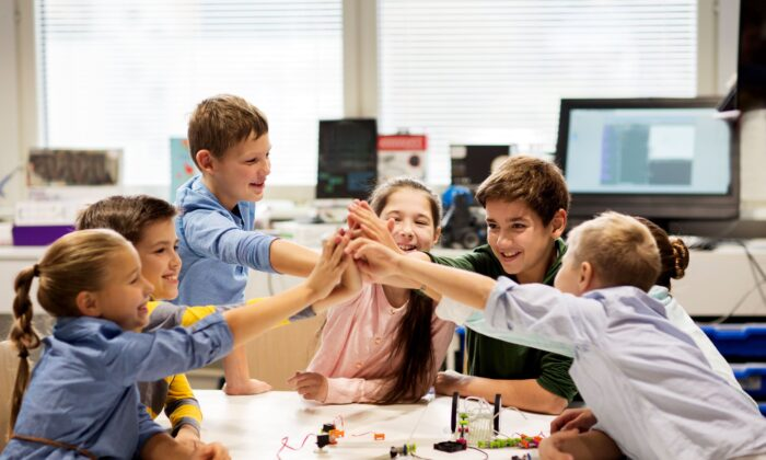 Anyone who thinks it's possible to keep students six feet apart throughout the school day has no understanding of what children are like when they are together. (Syda Productions/Shutterstock)