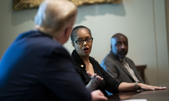 State Rep. Karen Whitsett of Michigan speaks with President Donald Trump at the White House in Washington on April 14, 2020. (Doug Mills-Pool/Getty Images)
