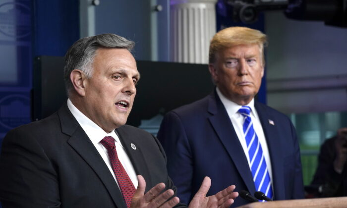 William Bryan, head of science and technology at the Department of Homeland Security speaks while President Donald Trump listens during a daily CCP virus briefing at the White House in Washington on April 23, 2020. (Drew Angerer/Getty Images)