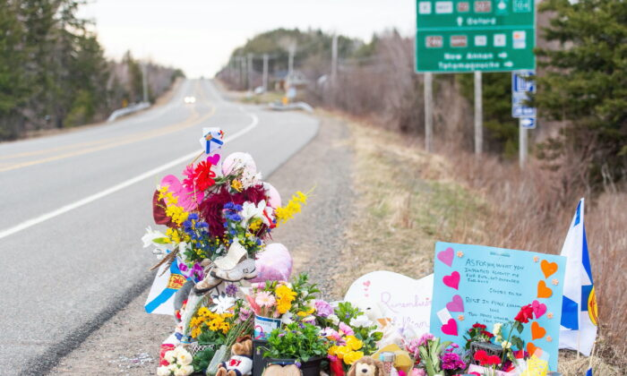 A memorial remembering Lillian Hyslop, who was killed in last weekend's murderous rampage in Nova Scotia, is seen along the road in Wentworth, N.S. on April 24, 2020. (The Canadian Press/Liam Hennessey)