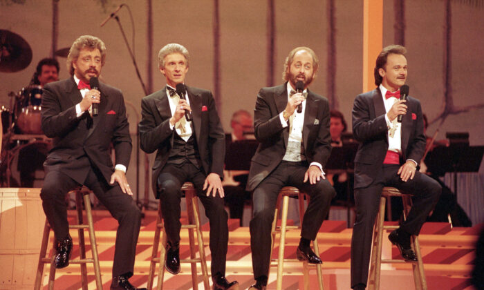 File photo of The Statler Brothers, from left, Harold Reid, Phil Balsley, Don Reid, and Jimmy Fortune, perform in Nashville, Tenn. May 7, 1992. (AP Photo/File)