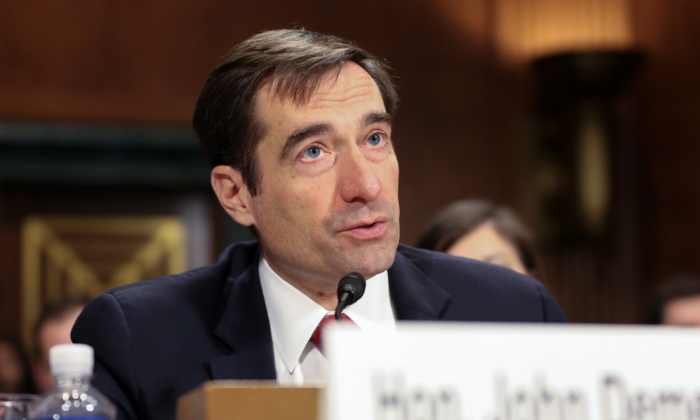 """John Demers, Assistant Attorney General, National Security Division, Department of Justice, testifies at the Senate Judiciary Committee hearing on """"China's Non-Traditional Espionage Against the United States: The Threat and Potential Policy Responses"""" in Washington on Dec. 12, 2018. (Jennifer Zeng/The Epoch Times)"""