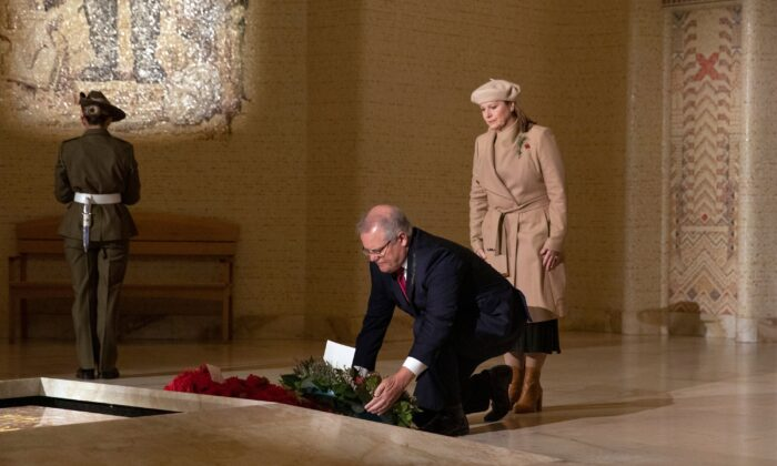 Australian Prime Minister Scott Morrison, accompanied by his wife Jenny, lays a wreath in the Hall of Memory during Anzac Day Commemorative Service at the Australian War Memorial in Canberra on April 25, 2020. (SEAN DAVEY/POOL/Getty Images)