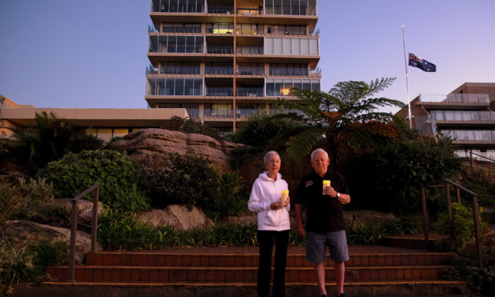 Ken and Jeanette Foster pay their respect outside their home in Fairlight on April 25, 2020 in Various Cities, Australia. (Cameron Spencer/Getty Images)