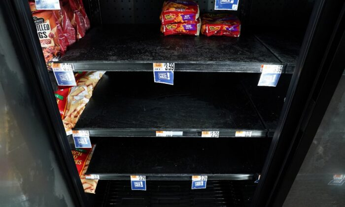 A few bags of frozen french fries are seen on sale in a freezer case at a Giant supermarket in Falls Church, Virginia, U.S., on April 23, 2020.(Kevin Lamarque/Reuters)