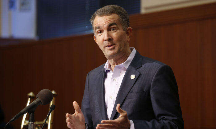 Virginia Gov. Ralph Northam gestures during a news conference at the Capitol in Richmond on April 8, 2020. (Steve Helber/AP Photo)