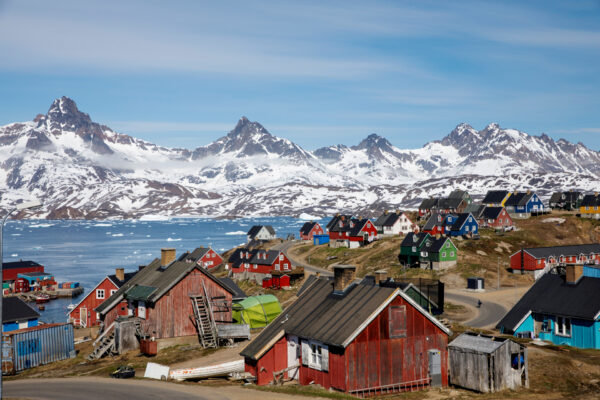Snow covered mountains rise above the harbor and town of Tasiilaq, Greenland, June 15, 2018. (Lucas Jackson/Reuters)