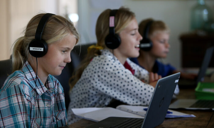 Alessia Bowman, 10, Sybella Bowman, 12, and Oliver Bowman, 8, do school work at their family home and cattle property on April 05, 2020 in Tarpoly Creek, Australia. (Lisa Maree Williams/Getty Images)