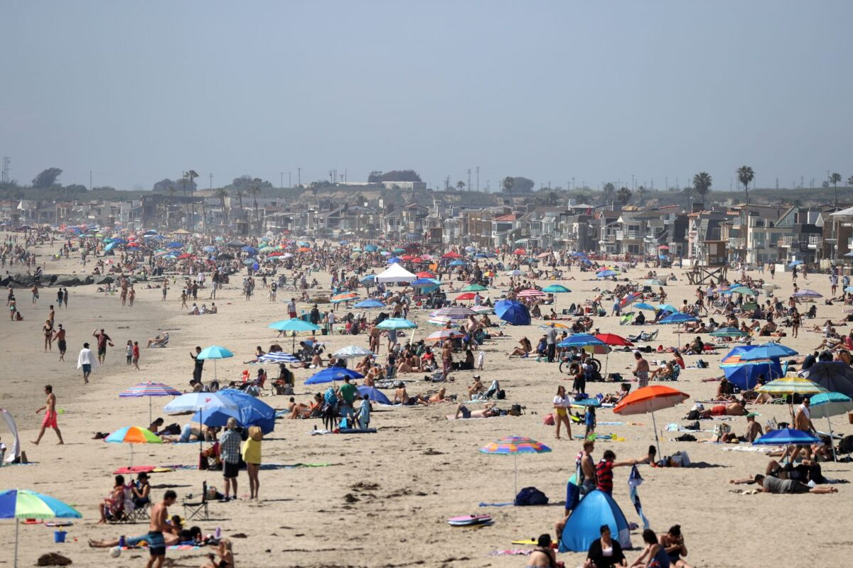 More than 50,000 people flock to California beaches amid pandemic