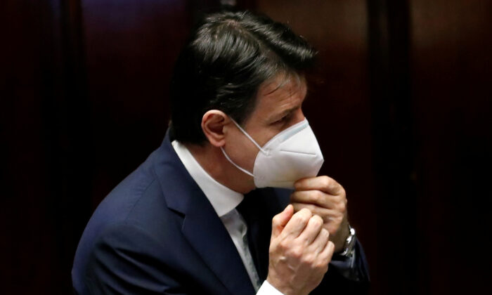 Italian Prime Minister Giuseppe Conte wears a face mask as he attends a session of the lower house of parliament on the CCP virus in Rome, Italy on April 21, 2020. (Remo Casilli/Reuters)