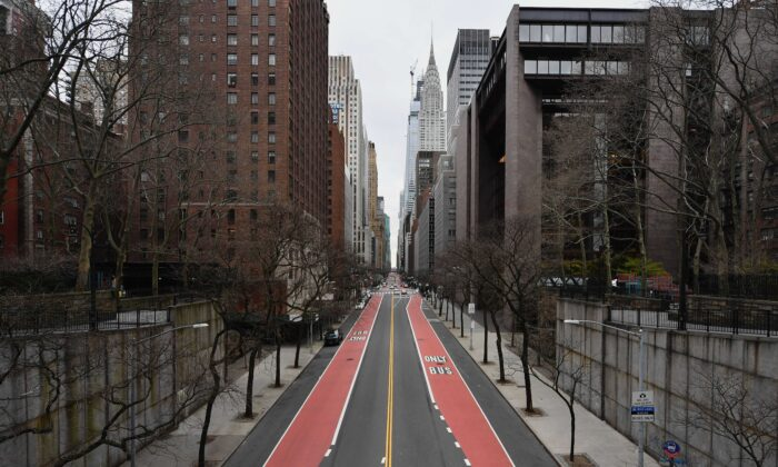 A nearly empty 42nd Street is viewed in New York City on March 25, 2020. (Angela Weiss/AFP via Getty Images)