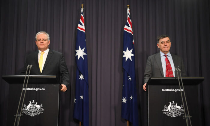 (L-R) Australian Prime Minister Scott Morrison and Australia's Chief Medical Officer Brendan Murphy address the media and the nation on March 24, 2020 in Canberra, Australia. (Lukas Coch - Pool/Getty Images)