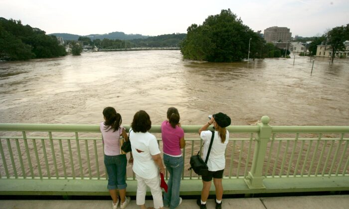 A family regards the swollen Delaware River from a bridge in Easton, Pa., on June 29, 2006. (Chris Hondros/Getty Images)