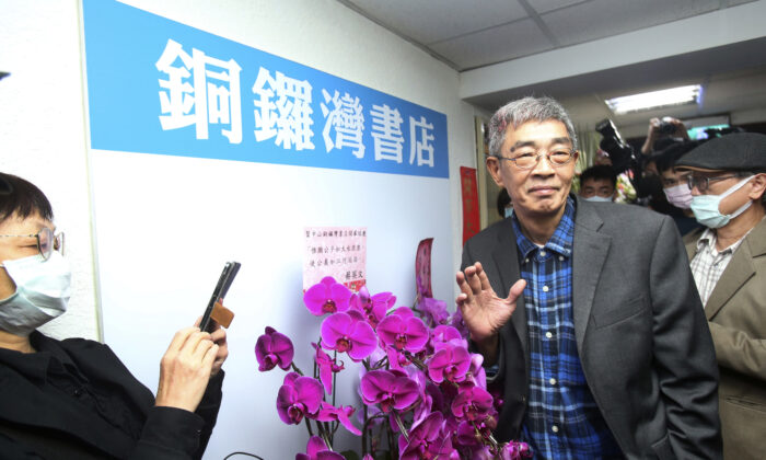 Lam Wing-kee, one of five shareholders and staff at the Causeway Bay Book shop in Hong Kong, waves to the press at his new book shop on the opening day in Taipei, Taiwan, on  April 25, 2020. (Chiang Ying-ying/AP Photo)