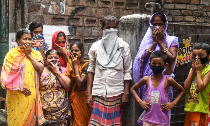 People protecting their faces during a government-imposed nationwide lockdown in Kolkata, India, on April 24, 2020. (Dibyangshu Sarkar/ /AFP via Getty Images)