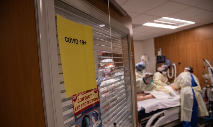 A team works on a COVID-19 patient at Stamford Hospital in Connecticut on April 24, 2020. (John Moore/Getty Images)